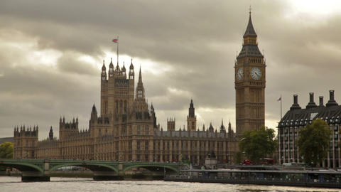 Big ben and Westminster palace, birds fly over water in foreground, located in L Footage