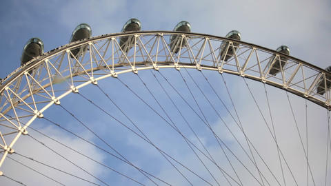 Low angle view of the London eye with blue sky background in London, England Footage