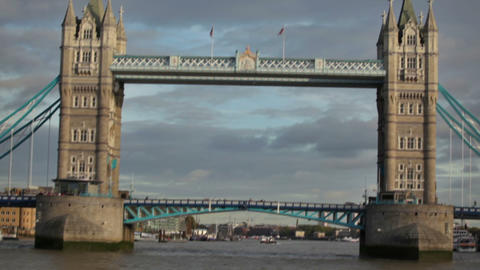 Cars drive and people walk across Tower Bridge, distant view, located in London, Footage