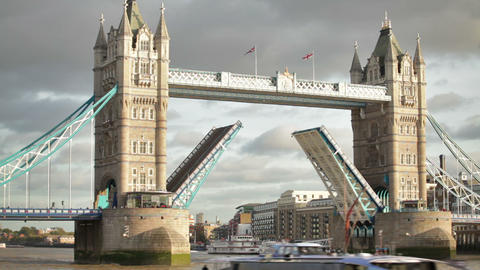 Boat passes through Tower Bridge with bascules raised, other boat in foreground, Footage