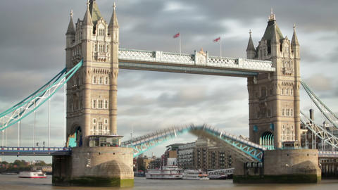 Time lapse of the Tower Bridge bascules raising, boats pass under, located in Lo Footage