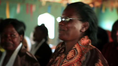 KENYA-C. 2012 Women and men sing and dance at an indoor... Stock Video Footage