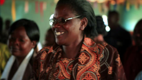 KENYA-C. 2012 Women and men sing and dance at an indoor social gathering in Keny Footage