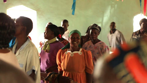 KENYA-C. People sing and dance between benches and in the aisle during worship i Live Action