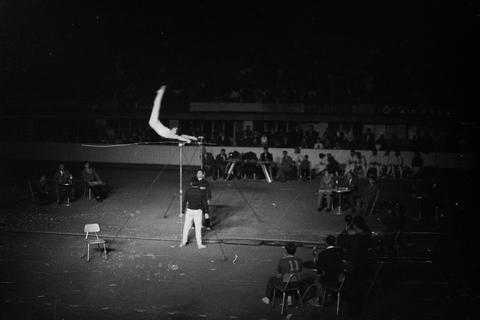 Gymnast on bar, in full swing. An old photo of an athletic meeting in Belgrade, Fotografía