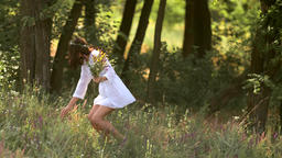 Natural beauty girl gathering flowers outdoor in freedom enjoyment concept Footage