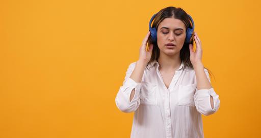 Happy girl listening music in her headphones Footage