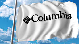 Waving flag with Columbia Sportswear logo. 4K editorial animation Live Action