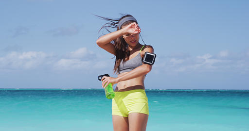 Runner Listening Music Drinking Water From Bottle While Jogging At Perfect Beach Footage