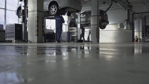 Indoor big pasted safety car service workshop with modern equipment on the Footage