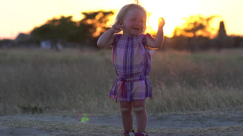 Joyful child. A delighted child enjoys nature. Children's emotions Live Action