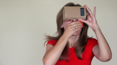 Emotional girl gets scared of view from virtual reality glasses. closeup Footage