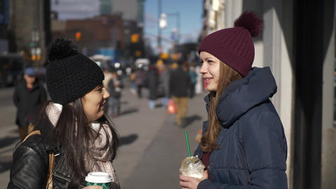 Two girls in the streets of New York on a sunny day Stock Video Footage