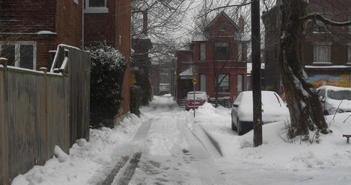 Establishing shot of an alleyway after winter storm Live Action