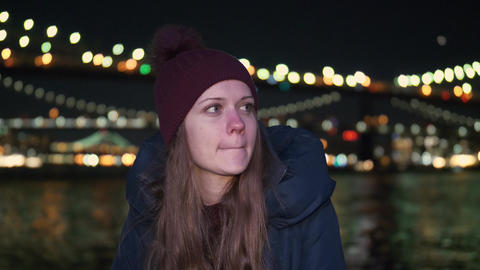Portrait shot of a young woman at Brooklyn Bridge by night Live Action