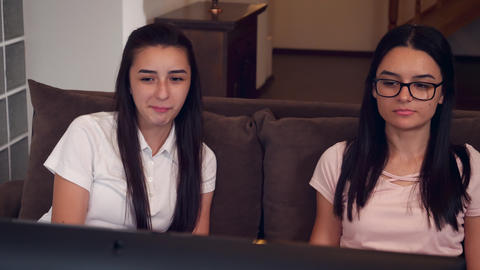 Teenage girls watching tv and relaxing at home Footage