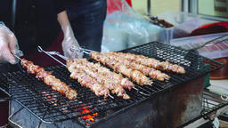 Grilling Meat, Street Food. Crocodile Meat Skewer Bbq Roasted In Asian Street Live Action