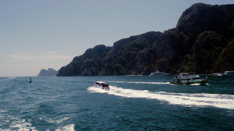Sailing and motor boats moving near the koh phi phi island pier in Thailand Footage