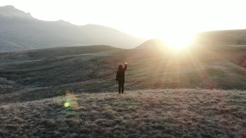 The boy starring hand toward sunlight Stands on the top of the hill Glare and Footage