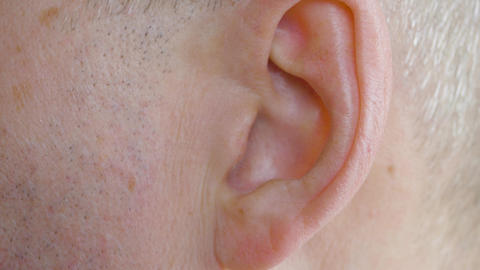 Male ear close up. Close up view man moving his ear, body part Footage