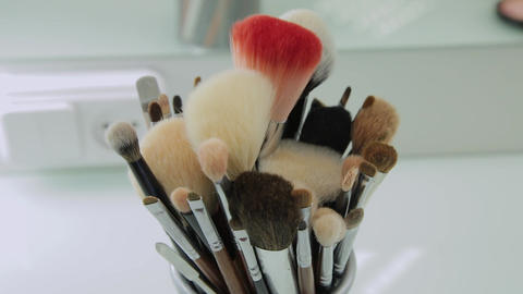 Set of brushes for make-up on table in dressing room. Fashion industry. Fashion Live Action