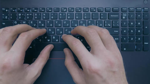 Two hands are typing on the keyboard of the laptop, top view, normal movement Footage