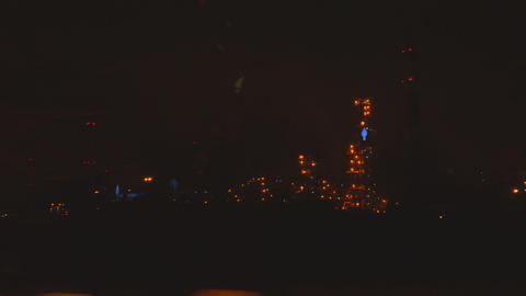 View of the oil refinery at night from the car window Footage
