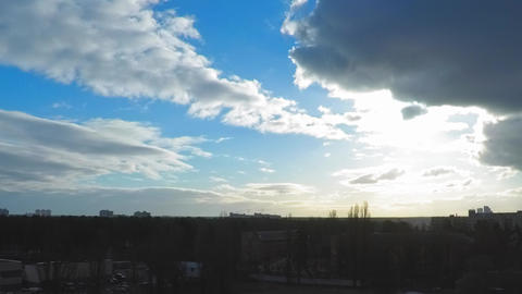 4K time lapse, the sun in the morning blue cloudy sky, the rapid movement of Live Action
