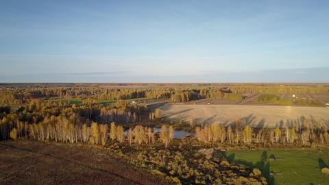 rural landscape with fields forests road and lake in autumn Footage