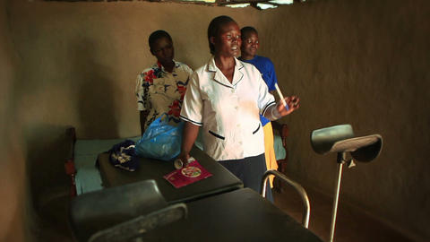 KENYA-C.2012 A doctor explains something while standing in a small room in Kenya Footage
