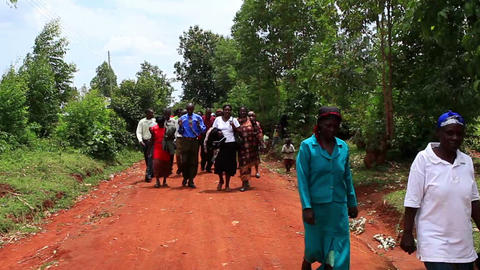 KENYA-C.2012 People walk toward and past the camera down a dirt road in Kenya, A Footage