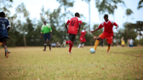 KENYA-C.2012 Two teams of African boys play an competitive game of football in K Live Action