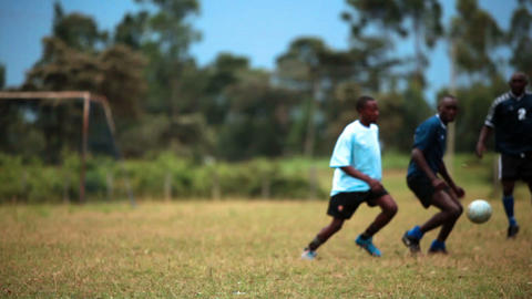 KENYA-C.2012 Two teams playing football on a grass field in Kenya, Africa c.2012 Live Action