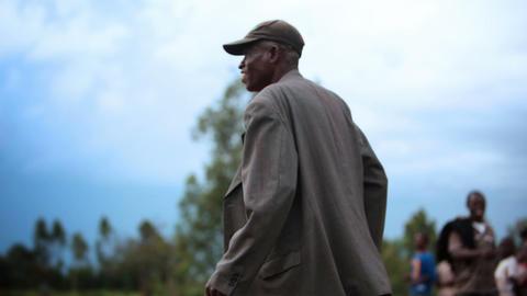 KENYA-C.2012 A man celebrates on the sidelines of a football field in Kenya, Afr Footage