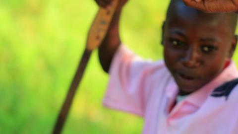 Children playing near a village in Kenya Footage