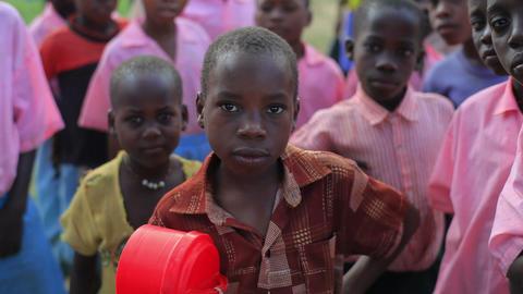 Children playing near a village in Africa Footage