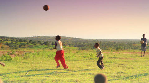 Children playing soccer on the fields in Kenya Footage
