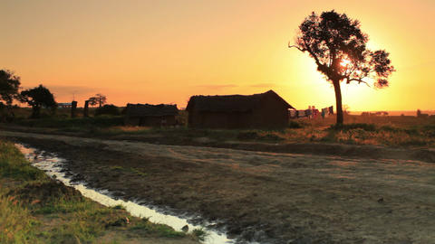 Dirt road and homes in Kenya at sunset Footage