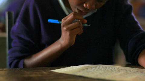 Close up of a student working in class in Kenya Footage