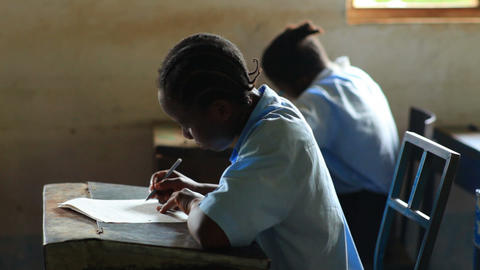 Boys and girls in a classroom in Kenya Footage