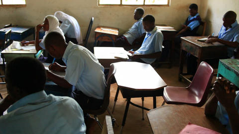 Boy and girl students in a classroom in Kenya Footage