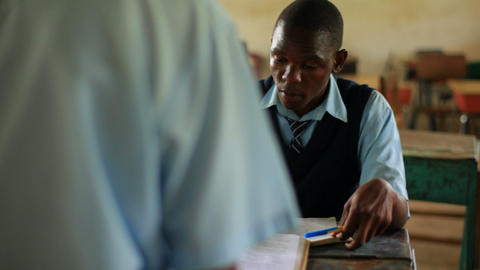 Students helping each other at school in Kenya Footage
