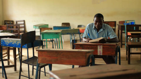 School boy doing homework in an empty classroom in Kenya Footage