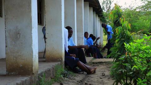 Students talking outside a school in Kenya Footage