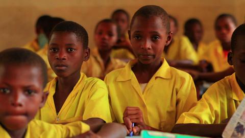School boys in a classroom in a school in Kenya Live Action