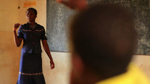 Teacher picking a child to answer a question in a Kenyan classroom Footage