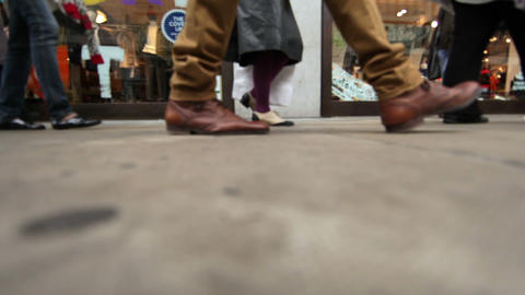 Low angle view of people walking on the side of the street in London Footage