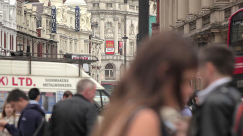 People and traffic at Piccadilly Circus in London Footage