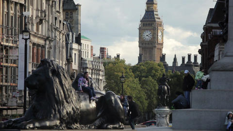 LONDON - OCTOBER 7: People climbing on Nelson's lions on October 7, 2011 in Lond Footage