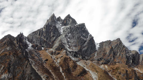 Panning shot of Time-lapse of clouds passing over rocky Himalayan peaks Footage